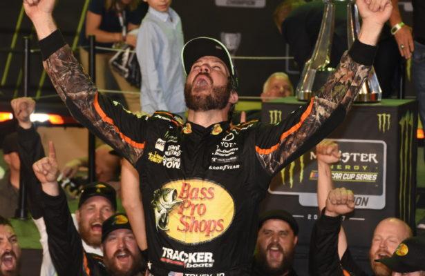 New Cup champion Martin Truex Jr. gives victory cheer atop his car. [Joe Jennings Photo]
