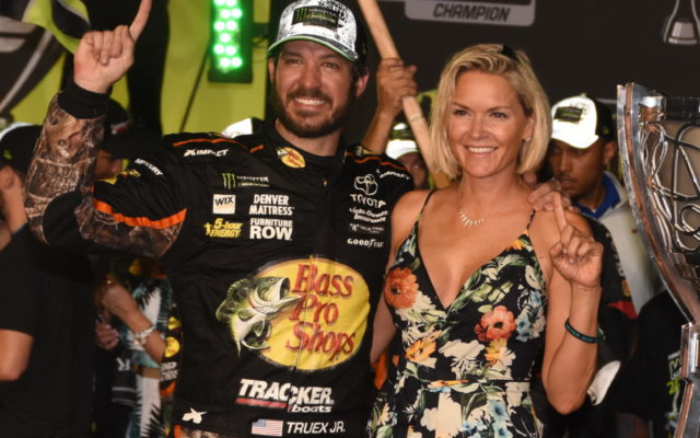 Martin Truex and his long-time girlfriend Sherry Pollex sport winning smiles.  [Joe Jennings Photo]