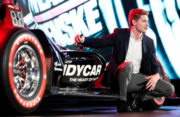 2017 Verizon IndyCar Series champion Josef Newgarden describes the 2018 Universal Aero Kit on stage during the 2018 INDYCAR unveil at the North America International Auto Show in Detroit. [Photo by: Joe Skibinski]