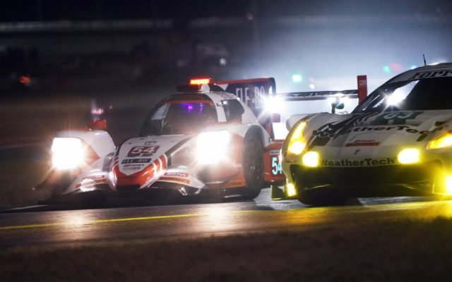 Close racing at night.  [Jack Webster Photo]