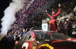Austin Dillon celebrates in Victory Lane after winning the Monster Energy NASCAR Cup Series 60th Annual Daytona 500 at Daytona International Speedway. [Photo by Jared C. Tilton/Getty Images]