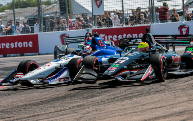 Graham Rahal (15) and Spencer Pigot get together and spin at the Grand Prix of St Petersburg.  [credit Andy Clary / Spacesuit Media]