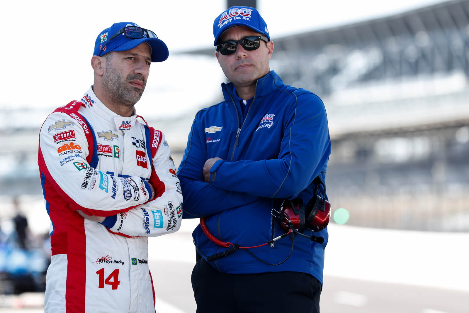 Tony Kanaan chats with team president Larry Foyt on pit lane during the open test at the Indianapolis Motor Speedway. [Photo by: Joe Skibinski]