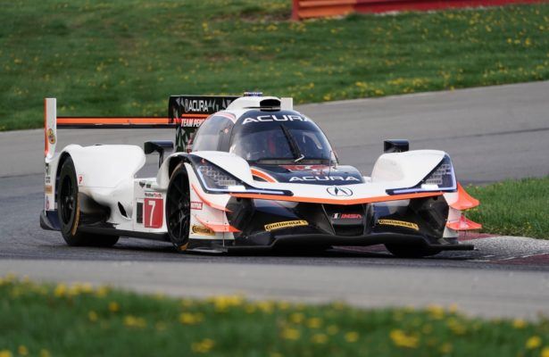 Race winning Team Penske Acura DPi driven by Helio Castroneves and Ricky Taylor. [Photo by Jack Webster]