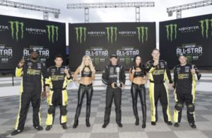 Matt Kenseth, middle, celebrates with Roush Fenway Racing crew members and Monster Energy girls after winning the pole for the Monster Energy NASCAR All-Star Race at Charlotte Motor Speedway. (HHP/Harold Hinson photo)