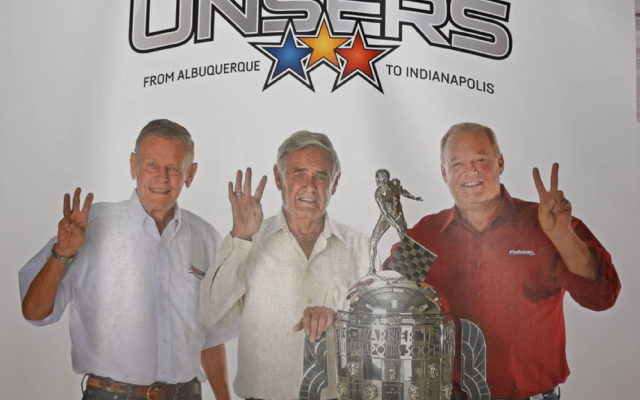 Bobby, Al and Al, Jr. Unser hold up fingers denoting their Indy 500 victories.  [Joe Jennings Photo]