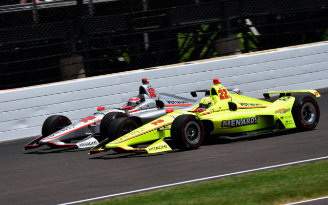 Teammates Will Power (12) and Simon Pagenaud (22) race through turn three at the Indianapolis Motor Speedway.  [John Wiedemann Photo]