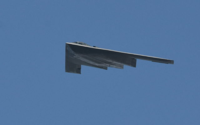 B2 Bomber performs a flyover during colorful pre-race ceremonies.  [Joe Jennings Photo]