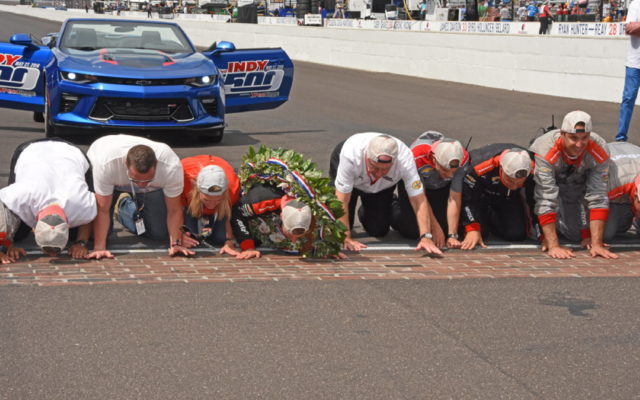 500 race winner Will Power and his team kiss the famed yard of bricks.  [Joe Jennings Photo]