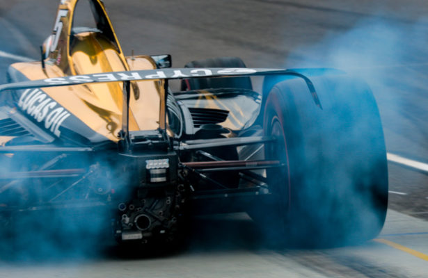 James Hinchcliffe smokes his tires leaving pit lane to get on track at the Indianapolis Motor Speedway. © [Andy Clary / Spacesuit Media]