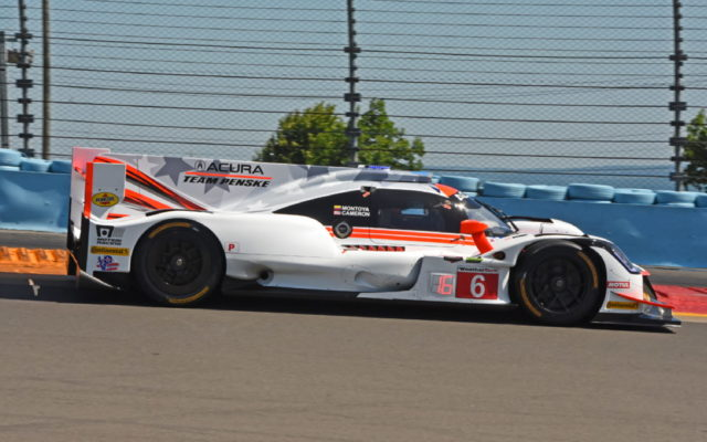 Team Penske Acura of Juan Pablo Montoya and Dane Cameron races through Turn 1.  [Joe Jennings Photo]