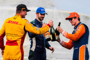 Ryan Hunter-Reay, Alexander Rossi and winner Scott Dixon celebrate on the podium. © [Andy Clary / Spacesuit Media]