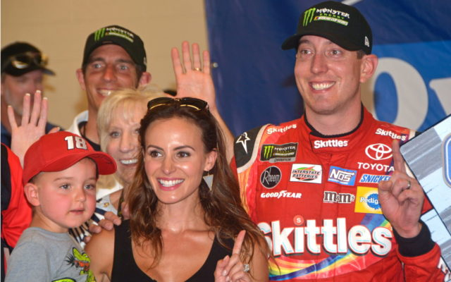 With a storm coming and impromptu victory lane ceremonies held in empty garage space, Kyle Busch celebrates with his wife Samantha and son Brexton after winning the Overtons 400 Monster Energy NASCAR Cup Series event at Chicagoland Speedway in Joliet, Ill., Sunday afternoon.  (Stan Kalwasinski Photo)