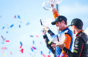Scott Dixon raises the trophy after winning the Honda Indy Toronto. © [Adam Piggot / Spacesuit Media]