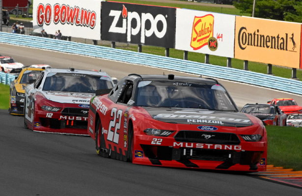 At the start of the l200, pole winner Joey Logano leads the field through the esses on the opening lap. [Joe Jennings Photo]