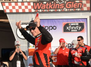 A jubilant Joey Logano celebrates his third Zippo 200 victory. [Joe Jennings Photo]