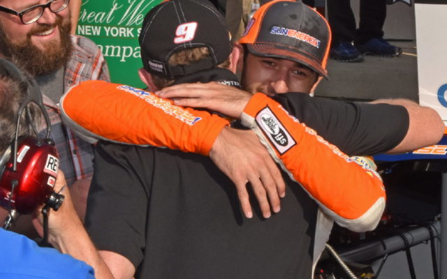 Bill Elliott gives his son Chase a victory hug.  [Joe Jennings Photo]