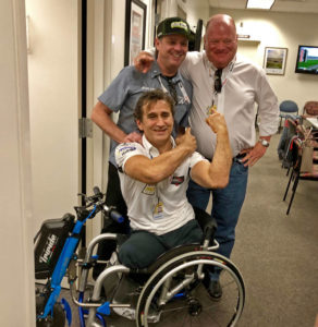 Alex Zanardi greeted by former car owner Chip Ganassi and former teammate Jimmy Vasser. [Joe Jennings Photo]