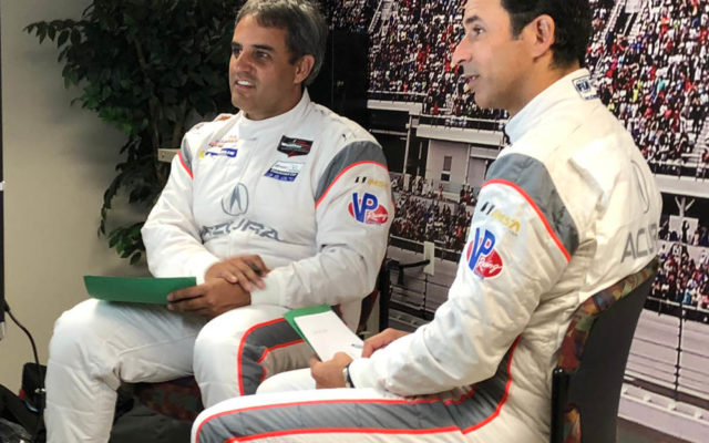 Juan Pablo Montoya and Helio Castroneves in the limelight doing a TV interview.  [Joe Jennings Photo]