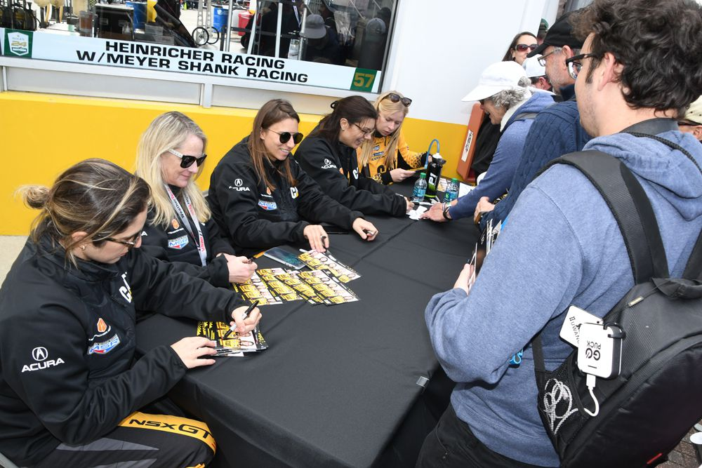 Catepillar drivers signing autographs in pre-race session. [Joe Jennings Photo]