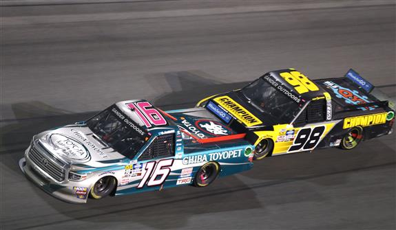Austin Hill (16) races Grant Enfinger (98) during the NASCAR Gander Outdoors Truck Series NextEra Energy 250 at Daytona International Speedway. [Jerry Markland/Getty Images]