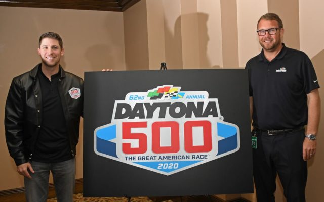 Denny Hamlin and DIS president Chip Wile unveil 2020 Daytona 500 logo.  [Joe Jennings Photo]
