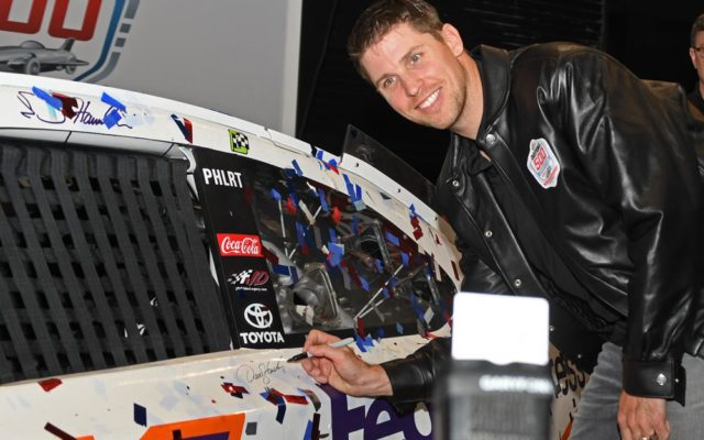 Denny Hamlin and all crew members took turns autographing winning car.  [Joe Jennings Photo]
