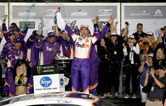 Denny celebrates in Victory Lane after winning the Monster Energy NASCAR Cup Series 61st Annual Daytona 500 at Daytona International Speedway. [Chris Graythen/Getty Images]
