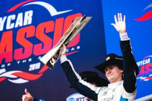 Colton Herta celebrates on the top step of the podium at Circuit of The Americas. © [Jamie Sheldrick / Spacesuit Media]