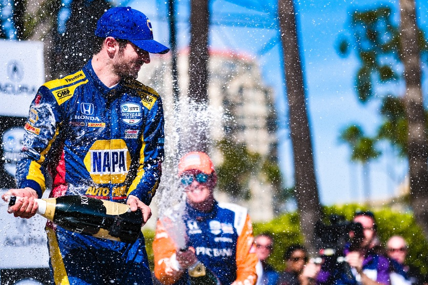 Alexander Rossi celebrates on top of the podium after a dominating win in the NTT IndyCar Series Acura Grand Prix of Long Beach © [Jamie Sheldrick/ Spacesuit Media]