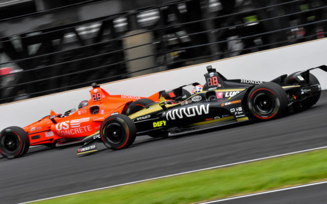 James Hinchcliffe passes Marco Andretti in the Indianapolis 500.  [John Wiedemann Photo]