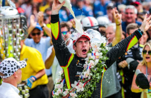 After winning the Indianapolis Motor Speedway, Simon Pagenaud dumped the milk on his head in celebration. © [Andy Clary/ Spacesuit Media]