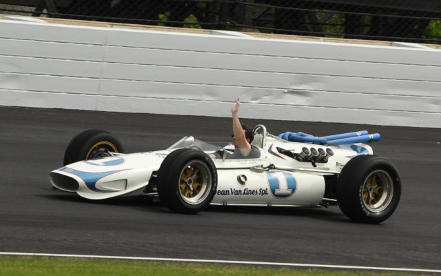 In tribute to Mario Andretti, son Jeff Andretti takes a slow lap in one of his dad's cars.  [Joe Jennings Photo]