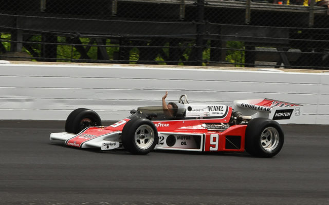 In tribute to Mario Andretti, son Michael Andretti takes a slow lap in one of his dad's cars.  [Joe Jennings Photo]