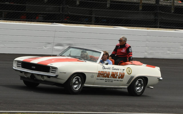 Mario Andretti rides around track in a 1969 Chevy Camaro, from the same year he won the 500.  [Joe Jennings Photo]