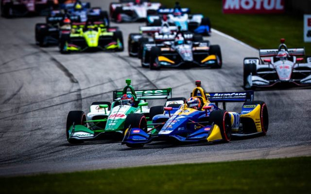 Alexander Rossi takes the lead on the opening lap in turn 3 at Road America.  © [Andy Clary/ Spacesuit Media]