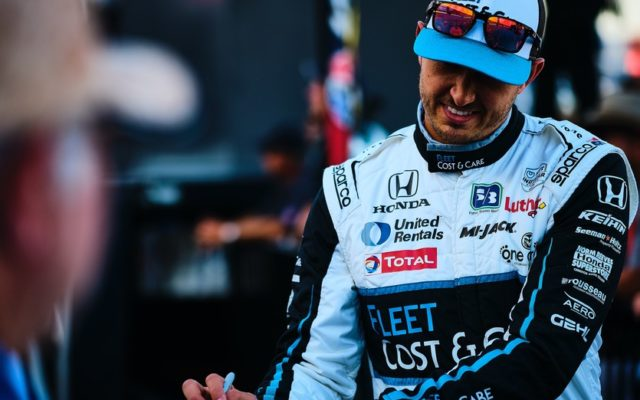 Graham Rahal signs an autograph prior to the race at Texas Motor Speedway.  © [Jamie Sheldrick/ Spacesuit Media]