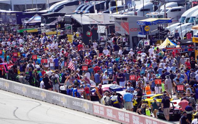 Fan walk in the pits.  [Photo by Jack Webster]