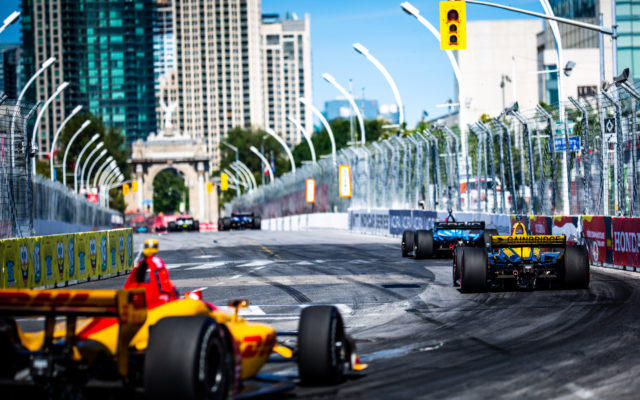 Zach Veach and friends down the straight in the Honda Indy Toronto.  © [Andy Clary/ Spacesuit Media]