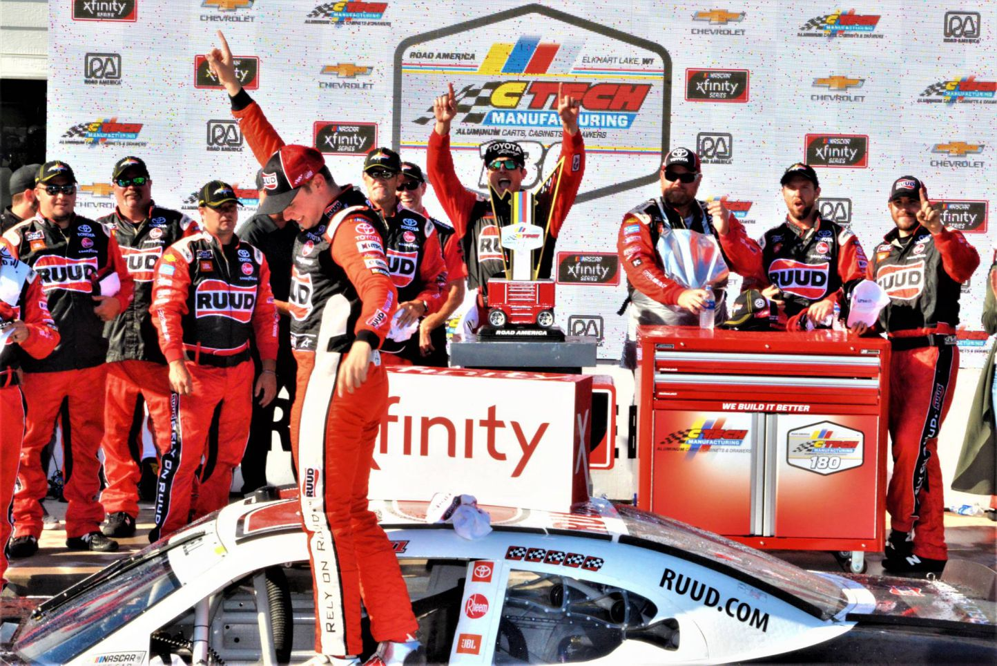 Christopher Bell celebrates with the team in victory lane at Road America. [Dave Jensen Photo]