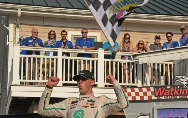 With checkered flag flying through the air, Austin Cindric begins his winner's celebration.  [Joe Jennings Photo]