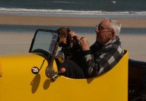 Greta, the dog, rides along with owner, Ray Stillwell.  [Joe Jennings Photo]