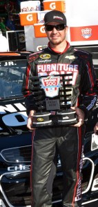 Martin Truex Jr. with the Front Row qualifier trophy at Daytona.  [Russ Lake Photo]
