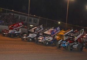 Late race battle among Daryn Pittman (9), Steve Kinser (11) and Donny Schatz (15)  [Joe Jennings Photo]