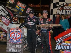 Steve Kinser, race winner, and Paul McMahon, week's sprint-car champion, shown with their championship trophies.  [Joe Jennings Photo]
