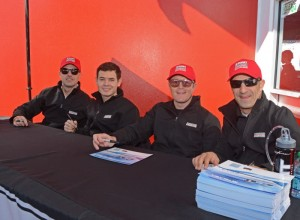 Kyle Larson shown in autograph line with teammates Marino Franchitti, Scott Dixon and Tony Kanaan.  [Joe Jennings Photo]