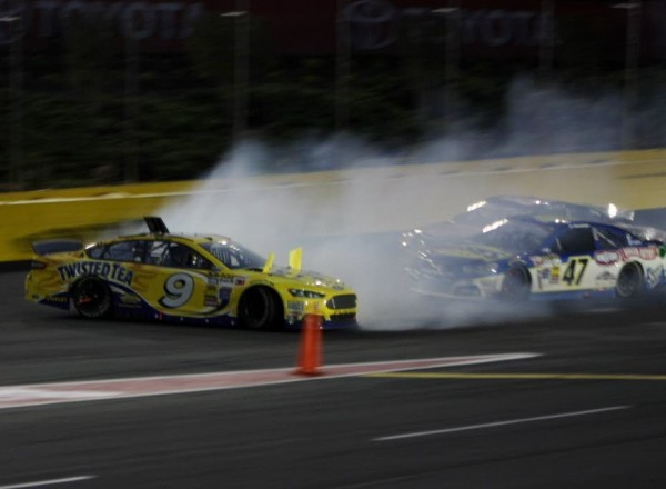 Marcos Ambrose spins out of turn four bringing out the caution flag.  [Everet Kamikawa photo]