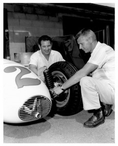 1961 Hoosier 100, A.J. looks over the Leader Card dirt car with driver Rodger Ward.  [Photo courtesy of the Indianapolis Motor Speedway]