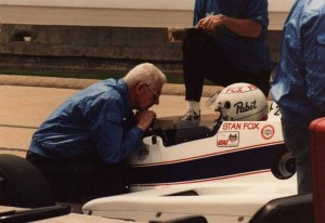 A.J. Watson leans in and debriefs Stan Fox at Indianapolis in 1984.  [Jim Debosik photo]