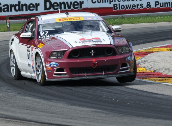 Mitch Landry lifts a wheel with his Ford Mustang Boss 302S  [John Wiedemann Photo]